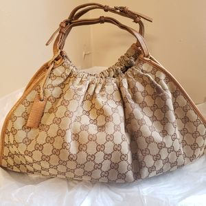 Gucci authentic GG Canvas gathered handbag